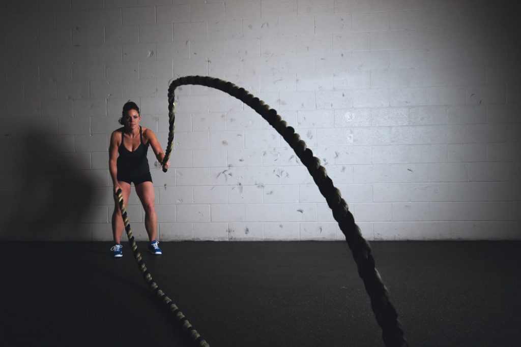 person working out with ropes